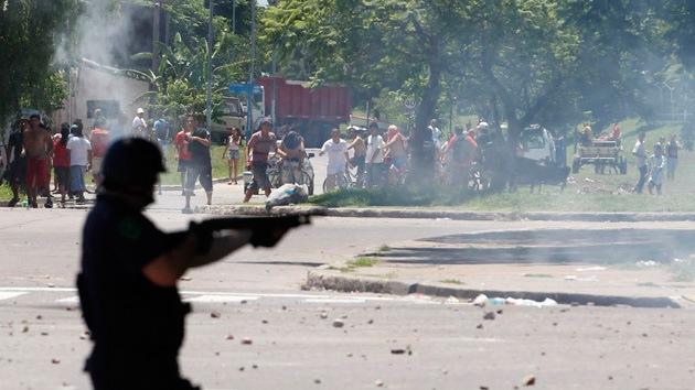 Fotos: dos muertos, decenas de heridos y cientos de detenidos en los saqueos en Argentina