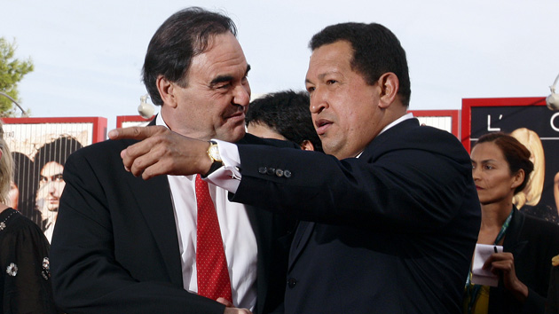 U.S. film director Oliver Stone (L) and Venezuela's President Hugo Chavez pose for photographers during a red carpet at the 66th Venice Film Festival September 7, 2009. REUTERS/Tony Gentile (ITALY ENTERTAINMENT POLITICS)
