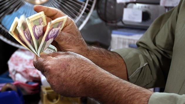 Irán planea 'liberarse' del dólar y el euro en el comercio exterior