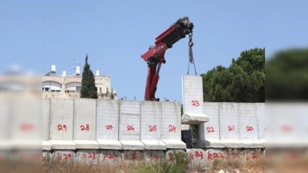 Israel empieza a desmantelar el muro entre judíos y palestinos
