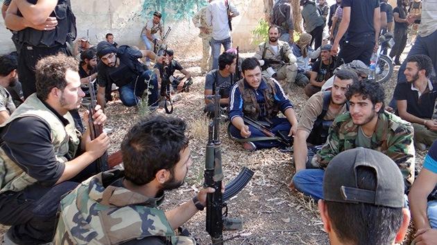 19 grupos de la oposición siria rechazan participar en Ginebra 2