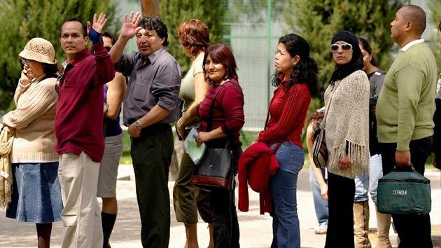 La crisis en España lleva a los inmigrantes peruanos a buscar el regreso a su país