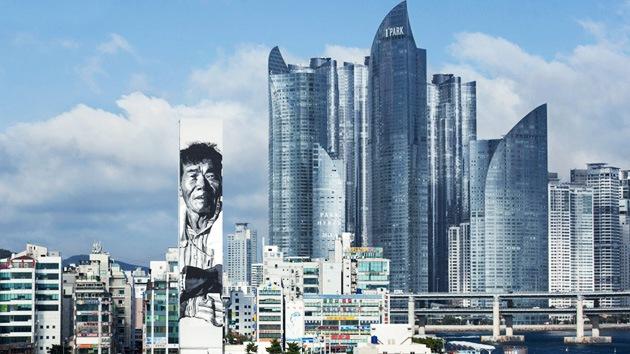 Fotos: Un artista alemán crea el grafiti más alto de Asia