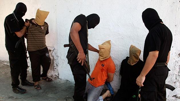 FUERTES IMÁGENES: EI publica un video en que matan a golpes a soldados sirios