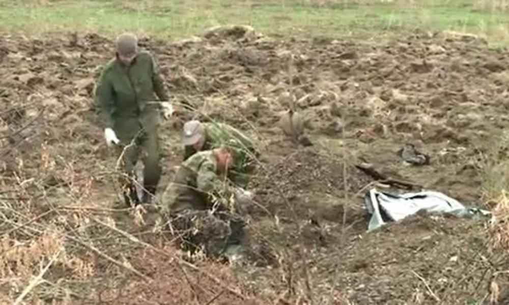 Nach Rückzug der ukrainischen Armee wird viertes Massengrab in Ostukraine gefunden