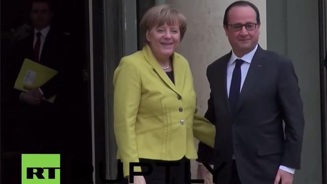 Live: Angela Merkel heißt François Hollande mit militärischen Ehren willkommen
