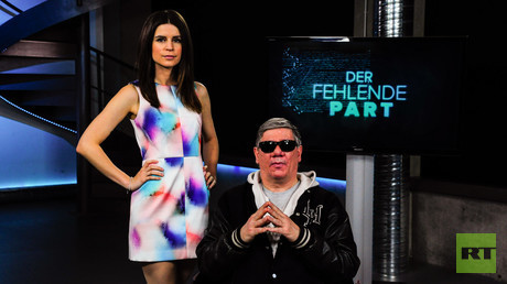 Neu-Zugang Claude-Oliver Rudolph und RT Deutsch-Moderatorin Jasmin Kosubek