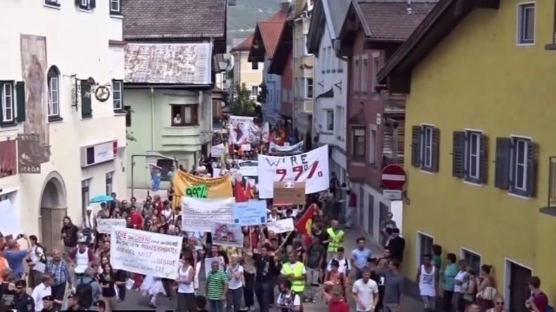 Proteste gegen das Bilderberg-Treffen 2013 in Tirol.