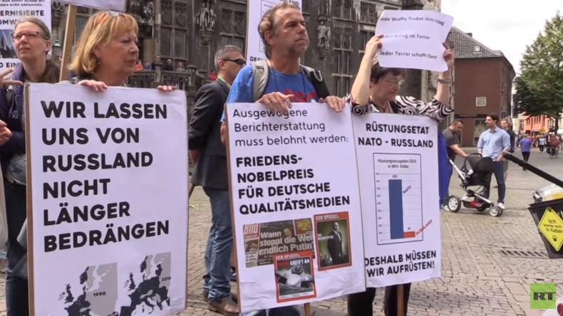 Zahlreiche Proteste gegen NATO-Gipfel und Militärmanöver