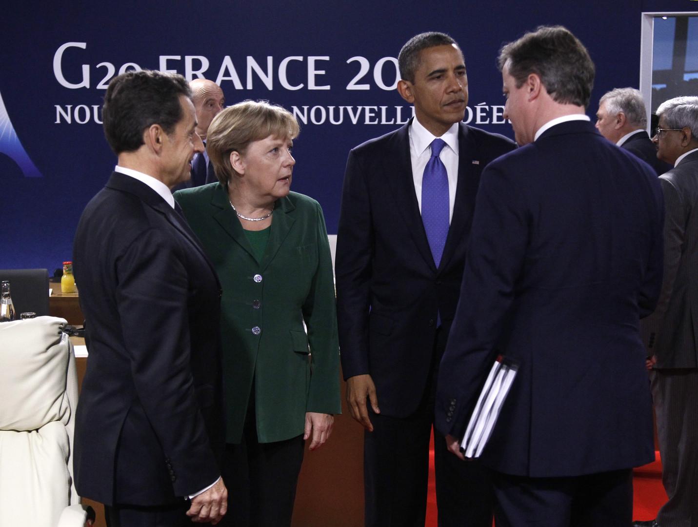 Schnell mit etwas anderem beschäftigt: David Cameron bei einem Treffen mit Nicolas Sarkozy, Angela Merkel und Obama vor dem G20-Gipfel in Cannes im November 2011.