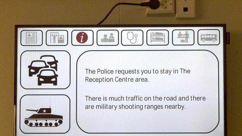 Ein Infobildschirm auf der norwegischen Seite der Grenze zu Russland.