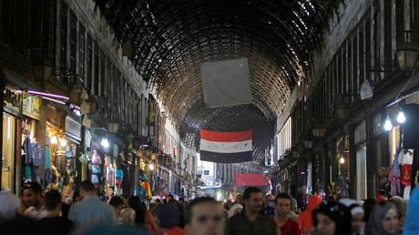 Straßenszene in Damaskus: Es gibt nicht nur Krieg in Syrien.