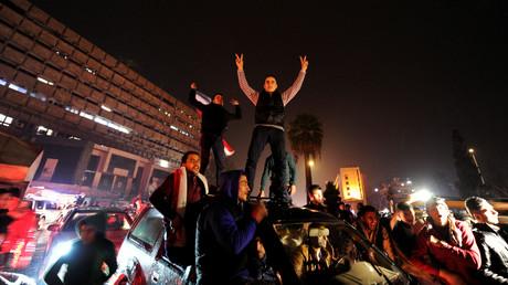 Regierungsanhänger feiern die Befreiung Aleppos.