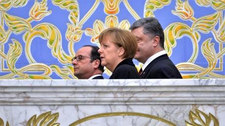 Bundeskanzlerin Angela Merkel, der ukrainische Präsident Petro Poroschenko und der französische noch-Präsident François Hollande am 12. Februar 2015 in Minsk.