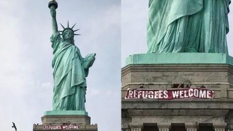 New Yorker Freiheitsstatue begrüßt Flüchtlinge mit Banner