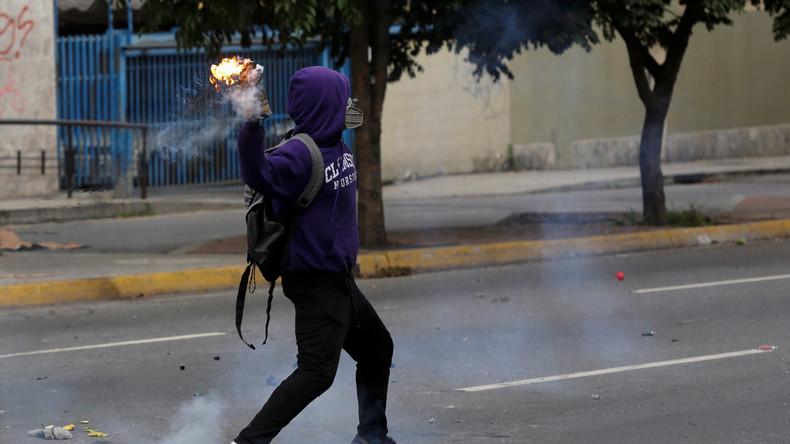 Venezuela: Demonstranten setzen Regierungsanhänger in Brand
