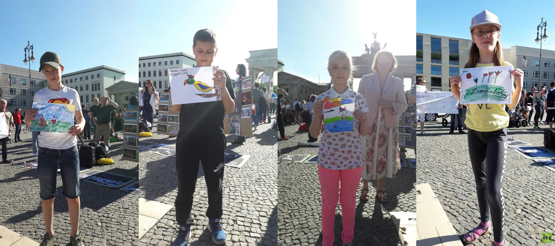 Gedenken an die Kriegsopfer im Donbass am Brandenburger Tor am Internationalen Kindertag