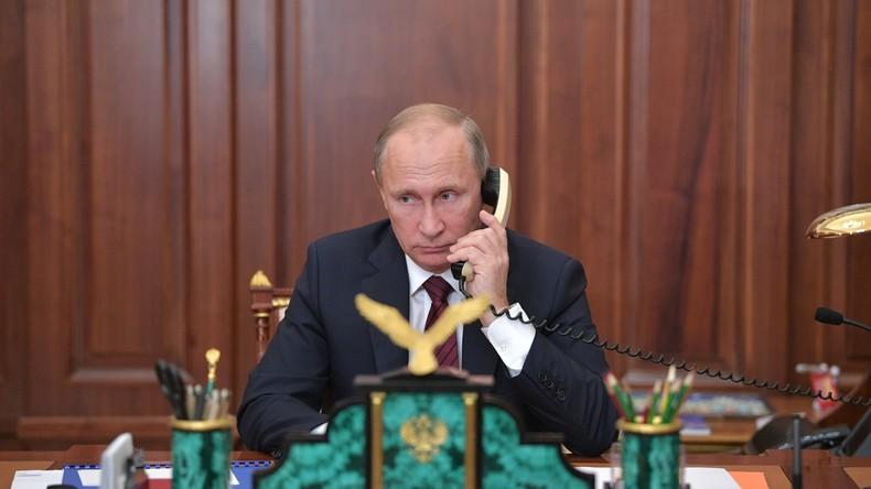 Merkel erkundigt sich bei Putin über Abzug der russischen Offiziere aus dem Donbass