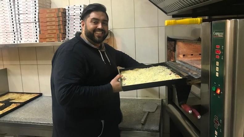 Pizzabäcker verteilt gratis 200 Pizzen an Obdachlose