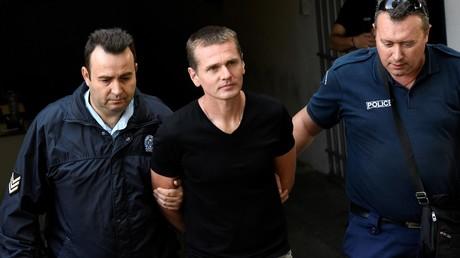 Alexander Vinnik (38) wird am 4. Oktober in den Gerichtssaal geführt.