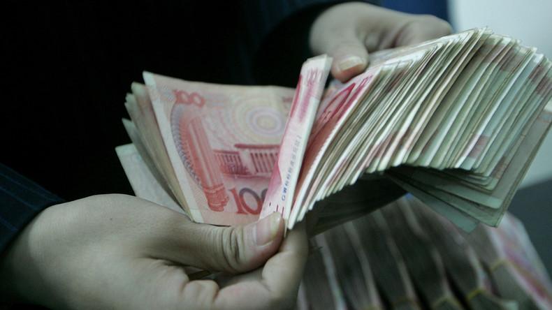 Zwei Männer in China nach Wettstreit im Geldverbrennen bestraft