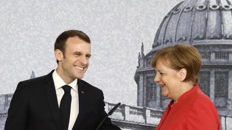 Bundeskanzlerin Angela Merkel und der französische Präsident Emmanuel Macron bei der gemeinsamen Konferenz im Berliner Humboldt Forum