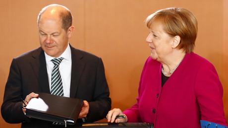 Merkel und Scholz: Schwarze Null als Obsession....