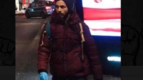 Ersthelfer? Attentäter? Der Mann mit den blauen Handschuhen.