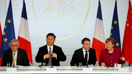 Chinas Präsident Xi Jinping beim Treffen mit dem Präsidenten der Europäischen Kommission, Jean-Claude Juncker, dem französischen Präsidenten Emmanuel Macron und der deutschen Bundeskanzlerin Angela Merkel am 26. März 2019.
