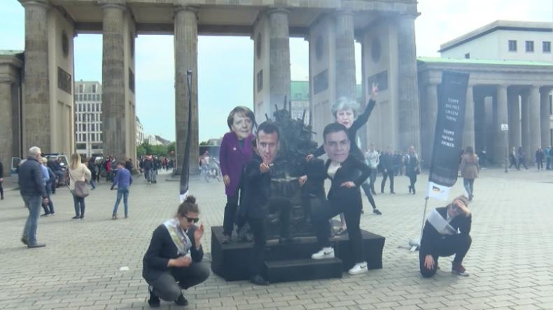 Berlin: Protest gegen Macron, Merkel und Co. wegen Waffenexporten nach Saudi-Arabien