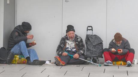 Obdachlose in der Einkaufsstraße
