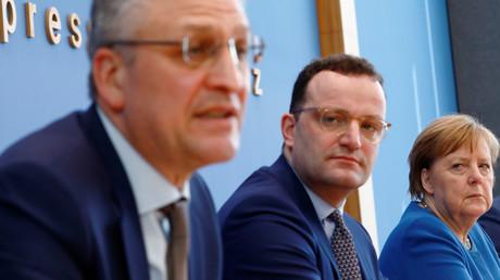 RKI-Chef Lothar Wieler, Gesundheitsminister Jens Spahn und Kanzlerin Angela Merkel bei einer gemeinsamen Pressekonferenz. (Berlin, 11. März 2020)