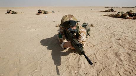 Krieg bringt immer zivile Opfer mit sich, aber die britische Regierung plant auch für vorsätzliche Folter im Irak und in Afghanistan effektive Straffreiheit per Gesetz. Auf dem Bild: Britische Soldaten vor dem Einmarsch in den Irak, 18. März 2003