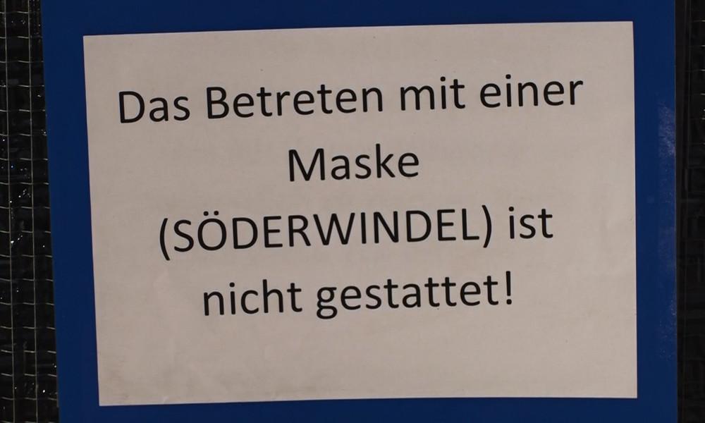 Runter mit der Maske! Kfz-Werkstatt in Bayern leistet stillen Widerstand (Video)