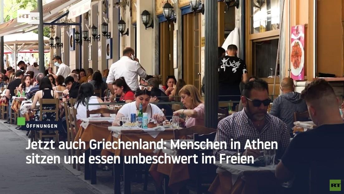 Jetzt auch Griechenland: Menschen in Athen sitzen und essen unbeschwert im Freien.