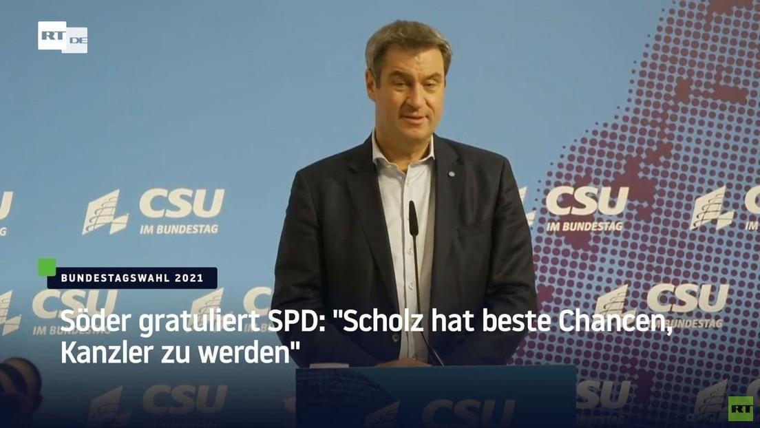 CSU-Vorsitzender Markus Söder gratuliert Olaf Scholz zum Wahlsieg