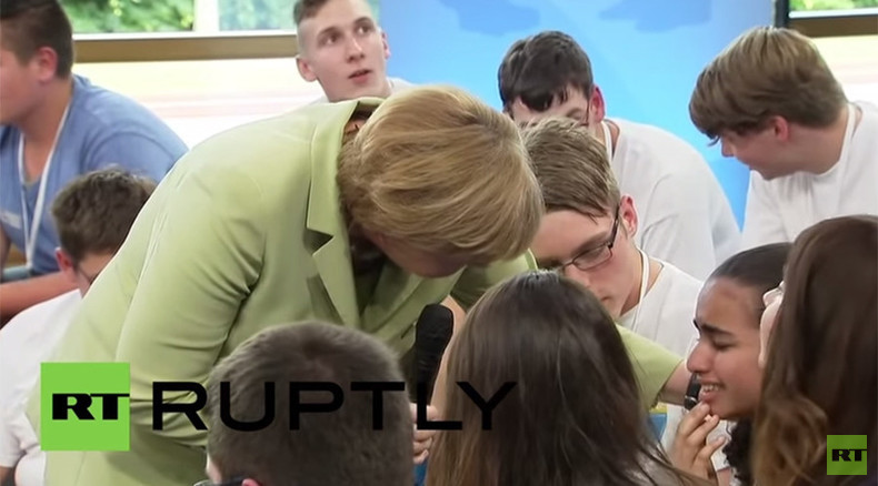 'We can't manage all you coming': Merkel makes Palestinian girl cry, then pets her