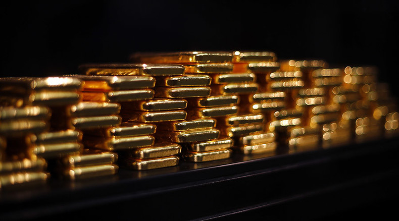 Gold touches 5yr low, as China suspected of heavy selling