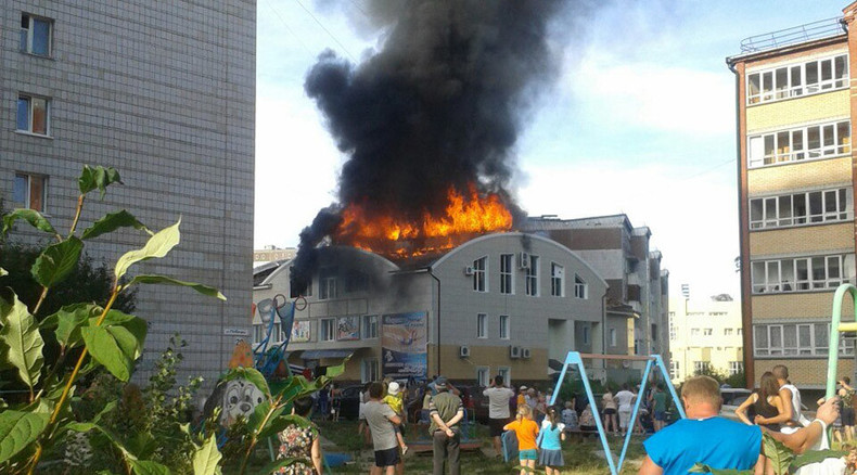 Shopping mall ablaze in Russia's Tomsk region, people evacuated