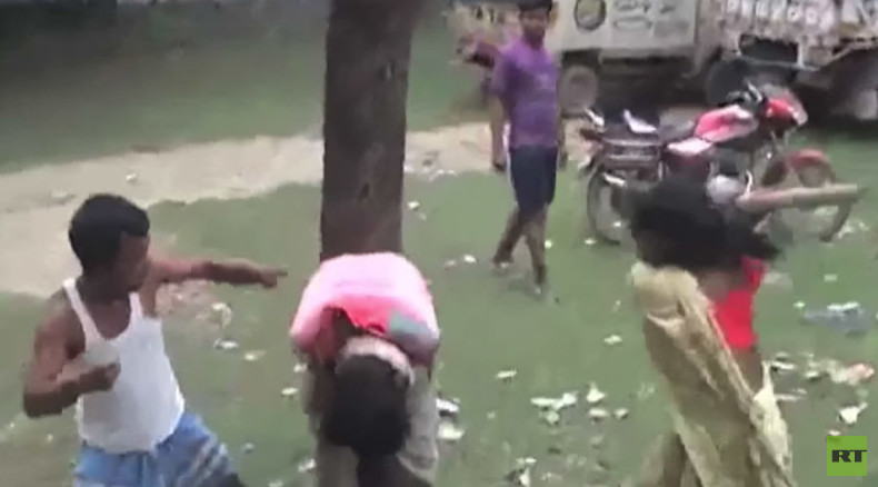 Vigilantes in India tie suspected molester to tree, beat him with broom (VIDEO)
