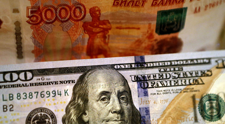 Ruble follows oil's route, touches 4-mth low
