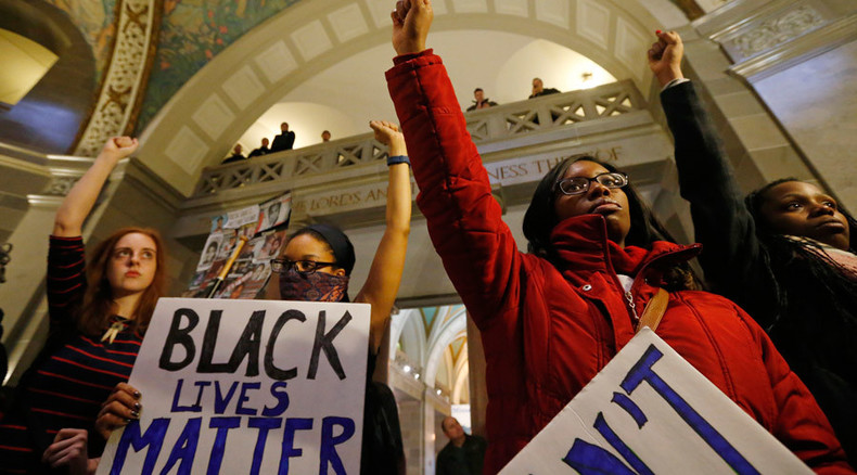Arrests, violence at Ferguson town hall as protesters confront mayor, clash with police
