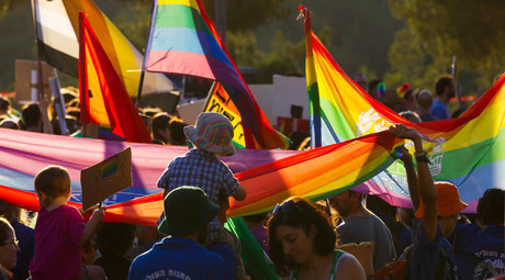 ARCHIVE PHOTO: Participants hold rainbow flags during the 12th annual gay pride parade in Jerusalem August 1, 2013. © Ronen Zvulun