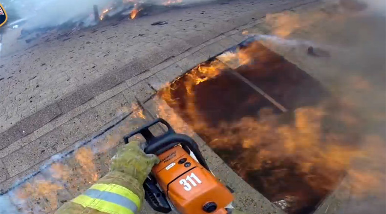 Thrilling body cam footage shows firefighters battling raging fire