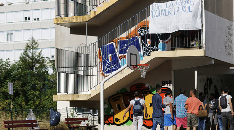 Paris 'generously' allows hundreds of migrants to stay in abandoned school