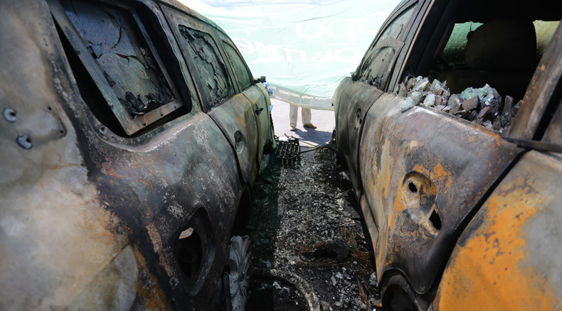 Ukraine OSCE mission's cars set on fire in Donetsk