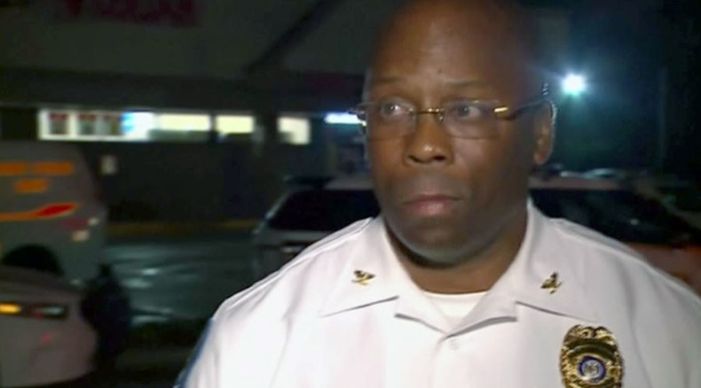 Ferguson police chief's 'we want to be patient as possible' comment upstaged by gunshots (VIDEO)