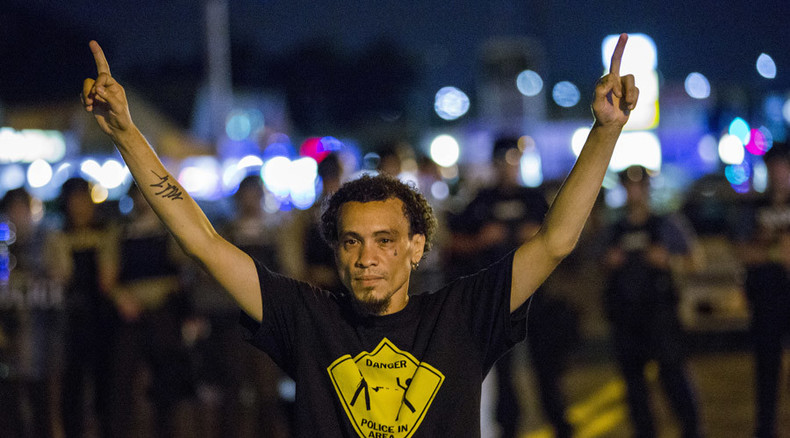 Ferguson police 'are inflaming tensions by declaring state of emergency'