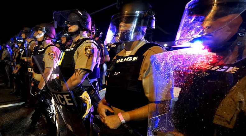 Picture of student shielding cops in Ferguson goes viral, becomes meme, leads to death threats