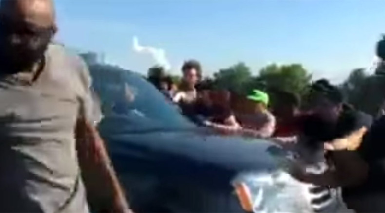 Two black women charged with blocking highway during Ferguson protests